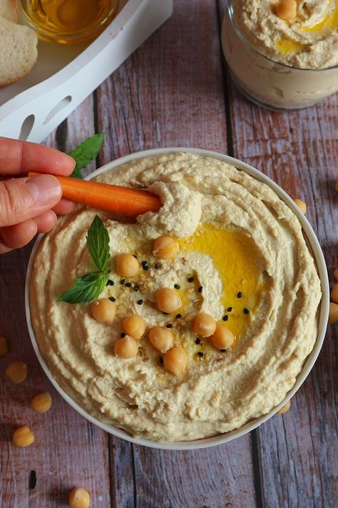 Creamy, fluffy, spicy, aromatic and so delicious is this oriental chickpea puree. It's vegan, healthy and versatile to serve. According to this recipe you can make the best classic hummus yourself. It's very easy, fast and with few ingredients.