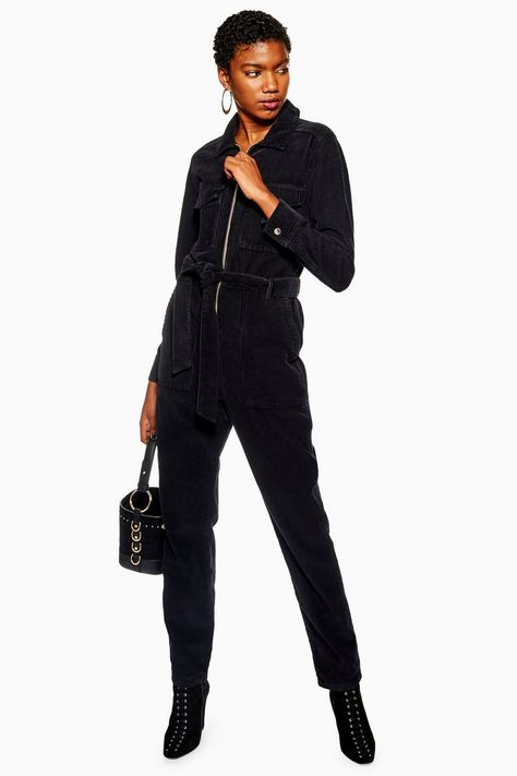 Nail the fashion-forward look with this super statement black corduroy boiler suit. We are accessorizing the stylish look with a handbag and adding some heeled boots for the ultimate outfit.
