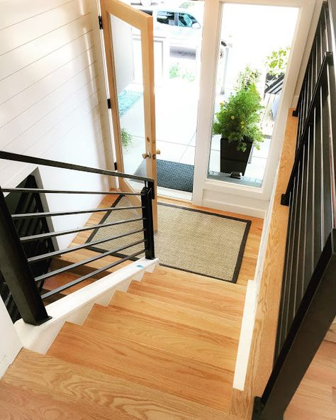 For the stairs we're going with a black iron railing. I like the You can find Split foyer and more on our website. Split Foyer Entry, Split Level Entryway, Split Level Kitchen, Split Level Home, Front Hallway, Split Entry Remodel Exterior, Split Level Exterior, Raised Ranch Remodel, Bi Level Homes