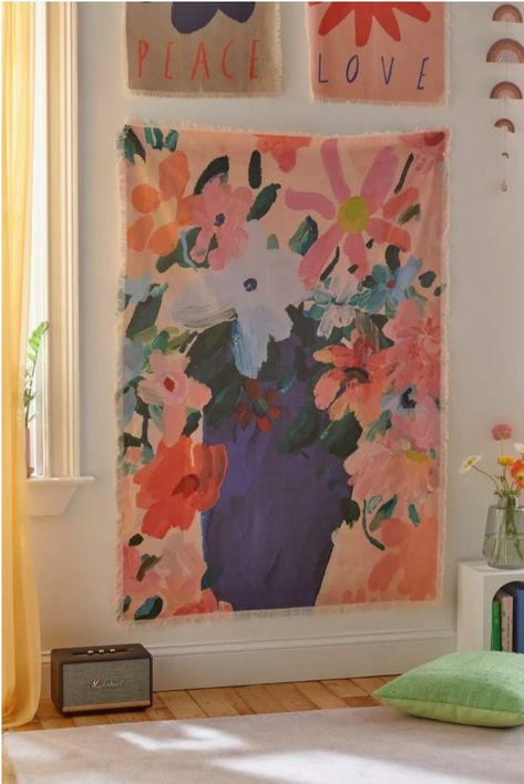 Bloom in your space with this painterly floral tapestry by artist we love, Katy Smail, available exclusively at Urban Outfitters. Colorful design is finished with raw fringed edges.