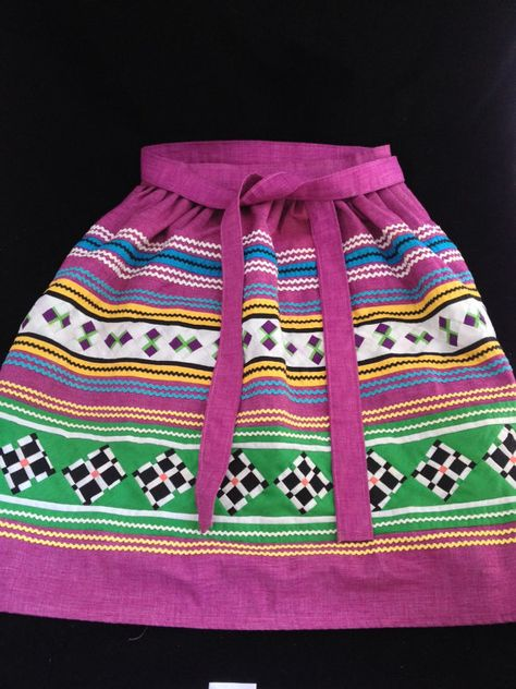 This purple and green apron is a stunning example of traditional Seminole Indian patchwork. Similar to the traditional skirts and dresses