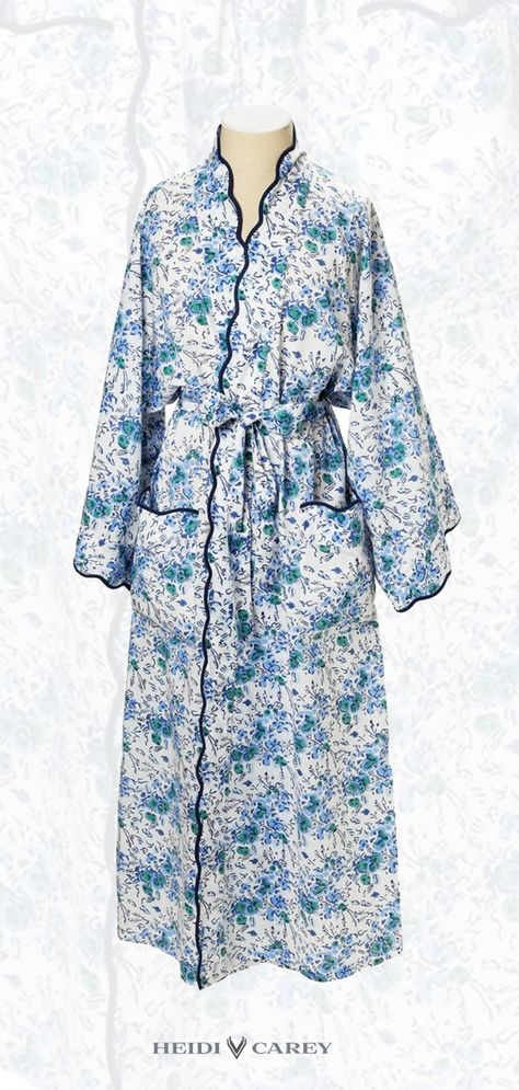 Best Seller. 100% cotton blue floral robe with navy scalloping.  Features wide arms, side pockets, a sash closure with belt loops and two interior ties. Hand made in Jaipur India.  I like a robe with plenty of fabric so it's comfortable and wraps around a bit. The robe has an interior tie to keep it in place and fitting perfect. Heidi Carey Collection #womensfashion #robes #handmade #India #floral #over40 #over50 #fashionforwomenover40elegant