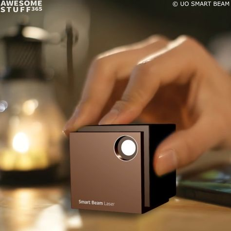 The UO Smart Beam mini portable projector can turn virtually any surface into an HD TV