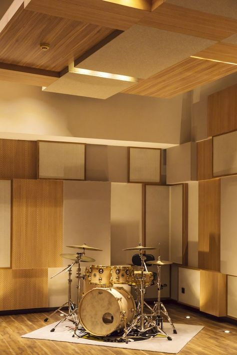 A drum kit in the Live A recording room. The wall and ceiling paneling is meticulously designed for optimal sound quality