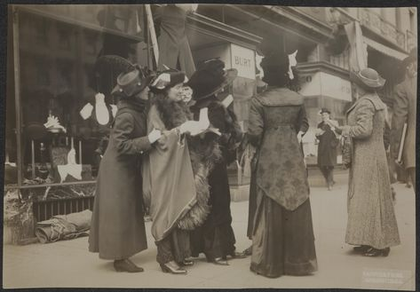 Suffragists distributing hand bills in January 1913 that advertise the suffrage parade that would take place on March 3, 1913.