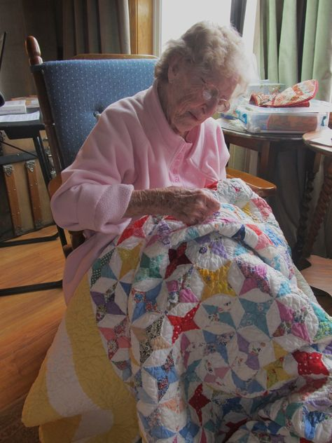 A beautiful Great Grandma, working on an antique quilt.