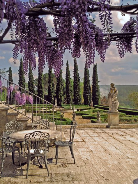 Table under Wistera overlooking La Selva Vacation Villas, Siena, province of Siena, Tuscany, Italy.