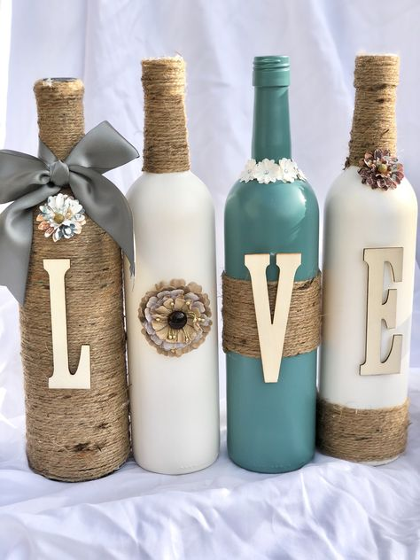 Wine Bottle Decor - DIY Crafts - Recycled wine bottles crafted with paint, twine, and letters to spell LOVE. These particular bottle - Old Wine Bottles, Recycled Wine Bottles, Wine Bottle Art, Painted Wine Bottles, Diy Bottle, Decorate Wine Bottles, Wine Bottles Decor, Crafts With Wine Bottles, Wine Corks
