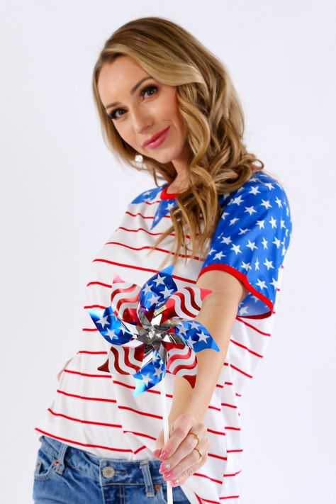 This tee is all you need for the 4th of July! Star spangled sleeves and a simple silhouette create a classic USA look for the celebratory holiday. 95% Polyester, 5% Spandex Hand wash cold, do not bleach, lay flat to dry Measures 25.75 from shoulder to hem on size small Size small is pictured Imported