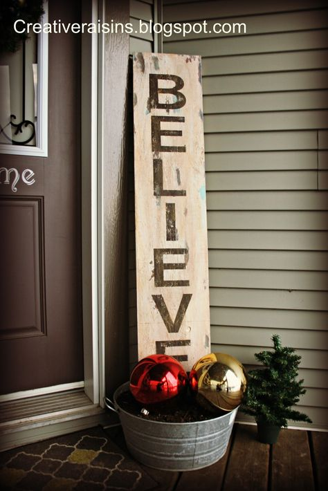 this was posted for Christmas (holiday sign + giant ornaments for the front) ... but I like the large sign idea just for anything!