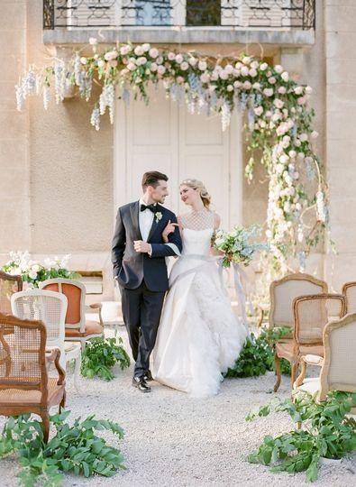 Whimsical Wedding Ceremony Decor Idea Floral And Greenery Arch Jessie Bar Wedding Ceremony Decorations Romantic Wedding Ceremony Wedding Photography Company