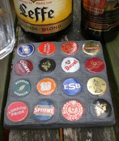 Mosaic Coaster from Beer Bottle Caps, this will go good on my coffee table with beer coasters.