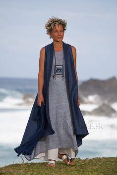 Love the vest -- shade of blue and shape, drape, length, high- low hem. Long blue summer linen vest and white flare pants