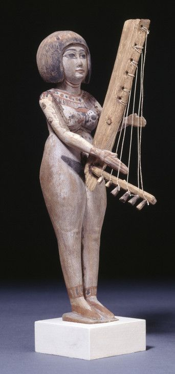 Ancient Egyptian Painted wooden figure of a female harpist, Late Period (664-332 BC)