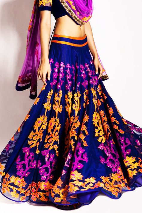Look at these bright colors on this indian outfit! Im loving the skirt!