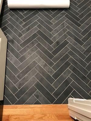 3x12 black honed slate laid in a