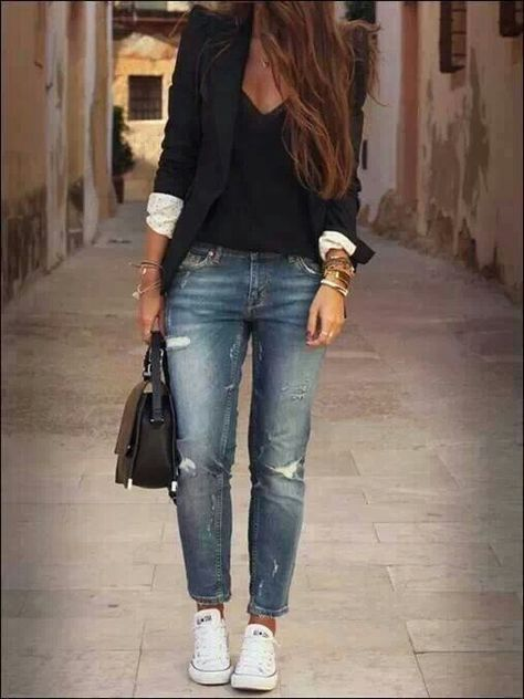 Black blazer over a black blouse with distressed boyfriend jeans and white converse sneakers Street Style. Really like the casual look mixed with the work look. Perfect for my job!