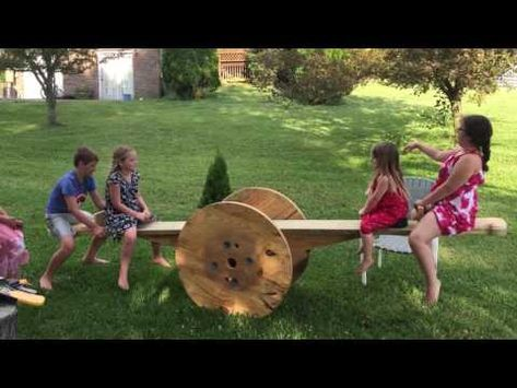Wooden wire spool seesaw teeter totter homemade - YouTube