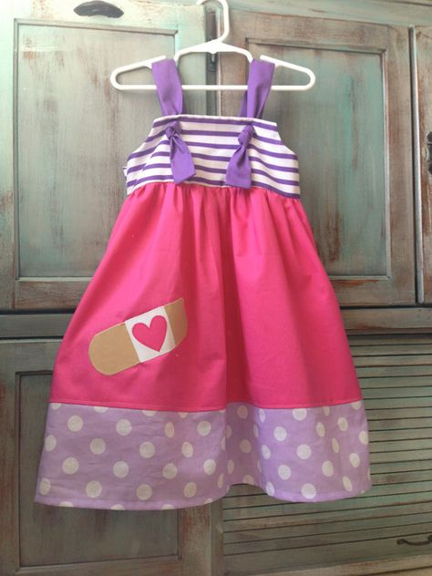 Doc McStuffins Knot Dress- hmmm I could maybe pull off making something like this......