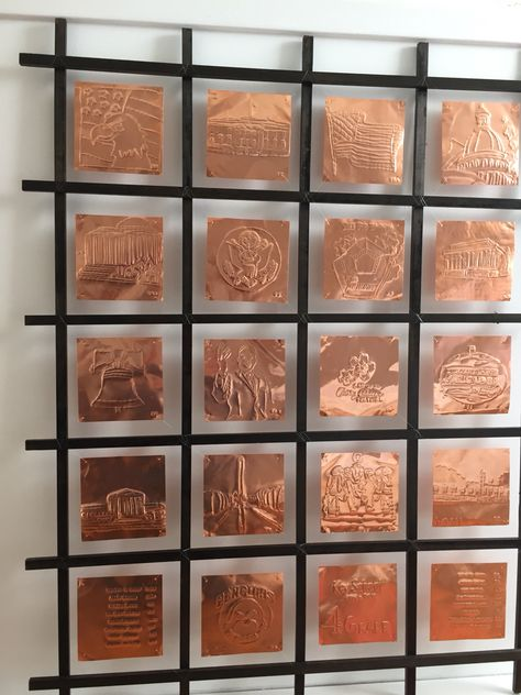 Every child traced and then carved on a 6 by 6 sheet of 5 mm copper square a monument from washington DC  The frame  make it complete great 4 grade auction class project