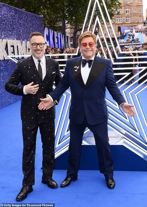 Confession: Elton John has revealed he didn't have 'joyous sex' until he was 23 and 'tore his clothes off' with his lover-turned-manager John Reid (Pictured with husband David Furnish)