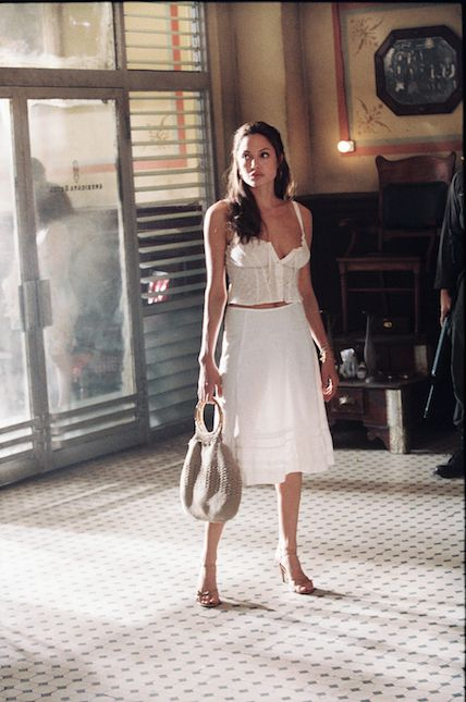 "d640a3cd619d29 Angelina Jolie rocks a white bodice and skirt in ""Mr. & Mrs. Smith."" ©2014  FOX All Rights Reserved"