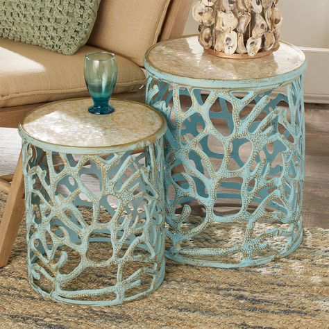 This beautiful set of two accent tables features sparkling Mother of Pearl table tops with coral motif metal frames finished in Weathered Blue. Perfect for adding coastal flair to your space! Large (19.5Hx16.5W), Small (16Hx13.5W). Decor, Coastal Decor, Cottage Style, Beach House Decor, Cottage Decor, House Interior, Coastal Bedrooms, Beach Cottage Decor, Accent Table Sets