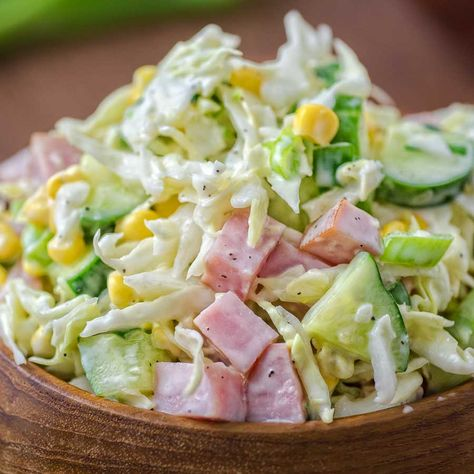 Made with fresh cabbage, cucumbers, ham, corn and scallions, this tasty and crunchy Cabbage and Ham Salad makes a quick lunch or side dish.
