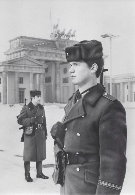 "East German Border Guards. Notice the cuff title, ""Grenztruppen der DDR"", which means, ""Border Troops of the GDR"" in English."