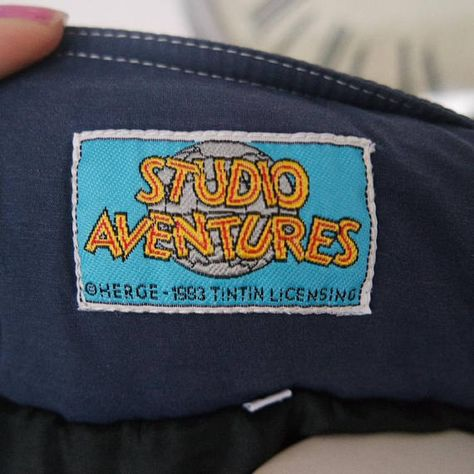 This blue jacket is by Studio Aventures and features the Tin