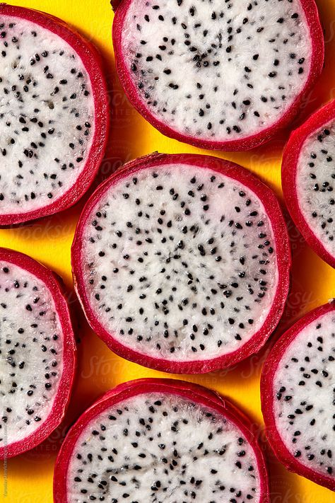 Close Up View Of Background From Round Slices Of Dragon Fruit Or | Stocksy United
