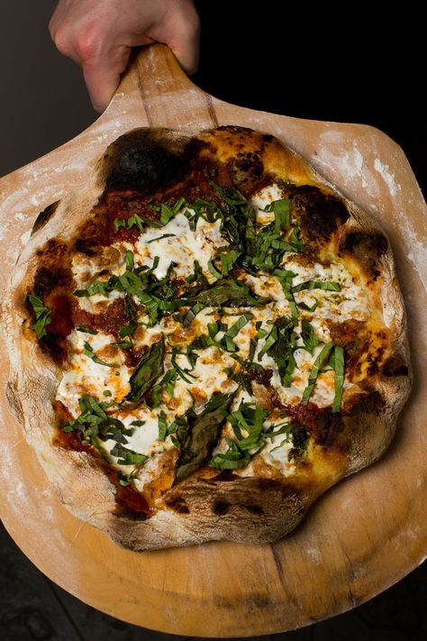 These Neapolitan-style pizzas are reminiscent of artisan wood-fired pies, but can be made in your home oven with a simple baking steel. This pizza is light but not flat; and substantial but far from bready, with a light and pillowy crust that Four A Pizza, Pizza You, Pizza Pizza, Crust Pizza, Pizza Rolls, Vegan Pizza, Neopolitan Pizza, Pizza Recipes, Cooking Recipes