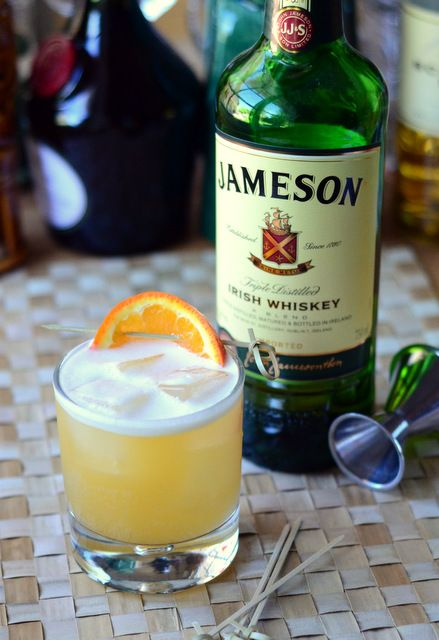 Irish Sour 2 oz Jameson Irish Whiskey 1 oz pineapple juice 1 oz orange juice oz lemon juice oz orgeat Combine all ingredients in a mixing glass and fill with ice. Shake vigorously until cold, then strain into a double old fashioned glass filled wi Jameson Irish Whiskey, Irish Whiskey Brands, Jameson Whiskey Sour Recipe, Scotch Whiskey, Irish Cocktails, Whiskey Cocktails, Cocktail Drinks, Cocktail Book, Bourbon Drinks
