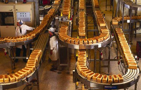 factory conveyor belt. factories are designed to make large amounts of the same product cheaply and efficiently. this photo shows a bread factory (industrial bakery) with\u2026 conveyor belt