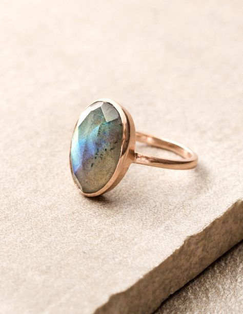 The Celestial Labradorite Ring is a bold, artisan-crafted ring that features a faceted oval labradorite. The stone is hand-set onto a rose gold plated band; a metal that is charged with the warmth of the Sun's energy.