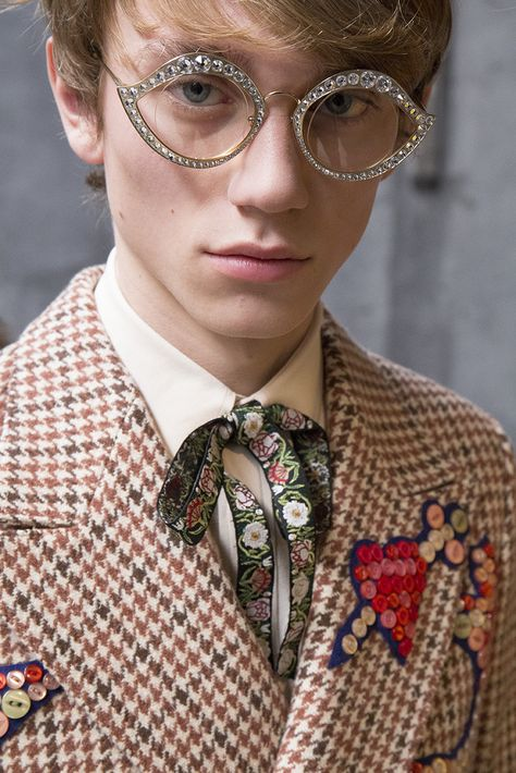 Cartoon characters, raw-cut fabrics and 18th century inspired jewelry on the Men's Fall Winter 2016 Runway.