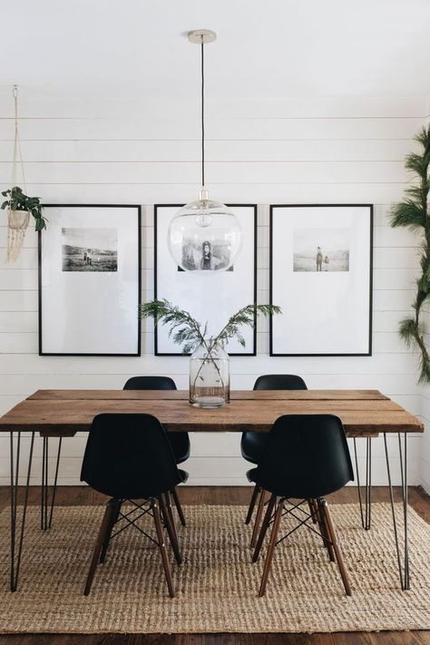 black and white dining room // woven rug // shiplap walls // glass globe pendant light