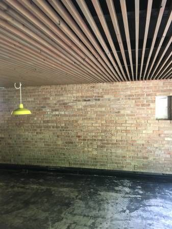 Slatted Ceiling In Basement Joists Cables Pipes And Subfloor Painted Black With Furring St Basement Ceiling Painted Basement Ceiling Cheap Basement Remodel