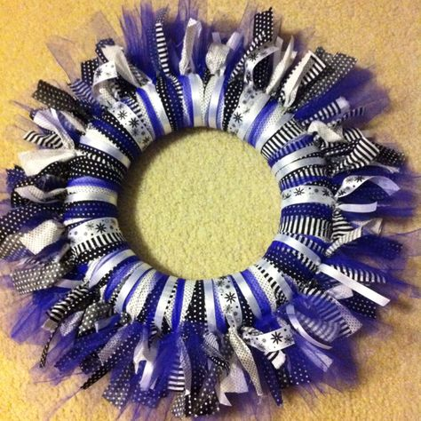 This wreath only took a few hours once everything was cut and ready. It's actually black and white with purple tulle and will have someone's (to remain nameless until after Christmas..duh it's a gift) in the middle tied with ribbon. For the initial, I bought a big letter at the craft store and painted it black. If I remember I'll post a pic of the final product later.