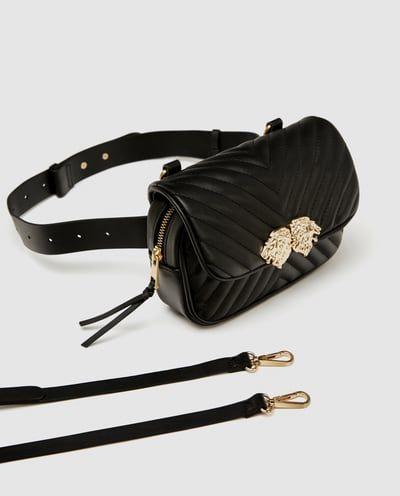 Gürtel und umhängetasche mit löwenverzierung | Taschen