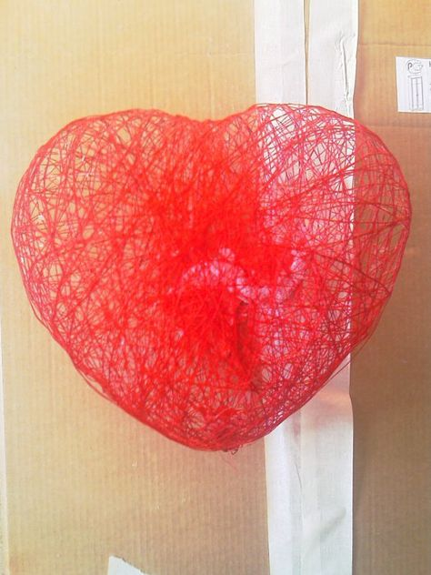wrap heart shaped balloon with red string soaked with 50%water&glue. dry then pop balloon