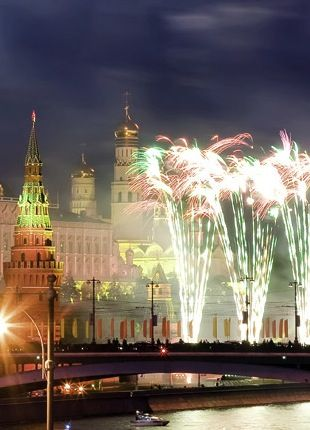 Fireworks blaze in Moscow's Red Square, where iconic sites like the Kremlin provide a dramatic New Year's Eve backdrop.
