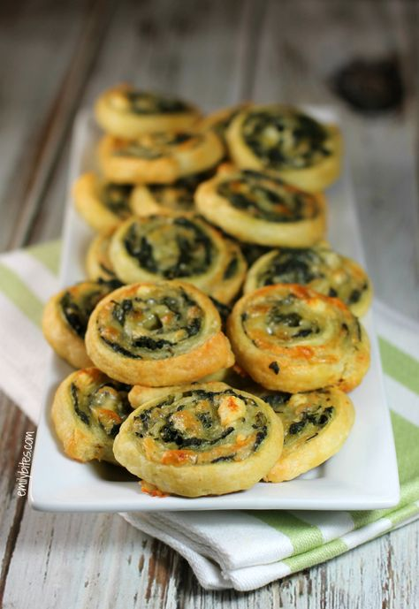 Cheesy Spinach Pinwheels - puff pastry  You can even prep them ahead of time and freeze them to serve later (you may have to cook them a few minutes longer from a frozen state).