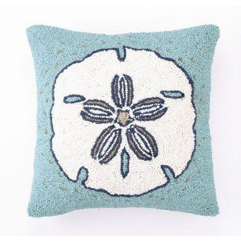 The Sand Dollar Hook Pillow matches the