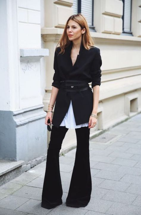 31 Perfect October Outfits To Make Fall Your Most Stylish Season Yet>> Dark wash jeans can look sophisticated enough for the office with the help of a belted blazer—and even bellbottom naysayers have to admit that, here, the style cuts a sharp.