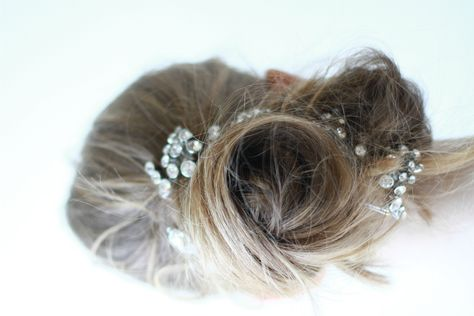 beautiful hairstyle {a bun with a touch of baby's breath}