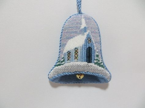 A dimensional needlepoint bell ornament stitched by Connie C.