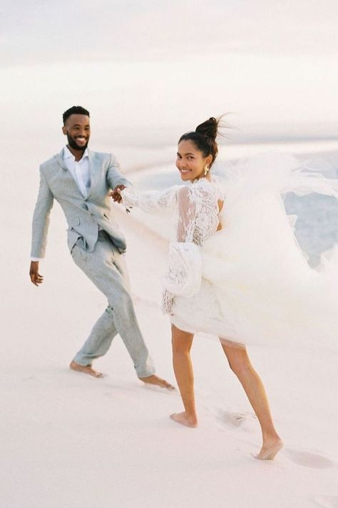 When it comes to incredible wedding photography, a white sandy beach never disappoints. 😍 This happy couple makes us want to book a trip to Bazaruto Island for a once-in-a-lifetime trip full of beauty! 🌴 | Photography: @stepanvrzalaphoto #stylemepretty #beachwedding #beachweddingdress