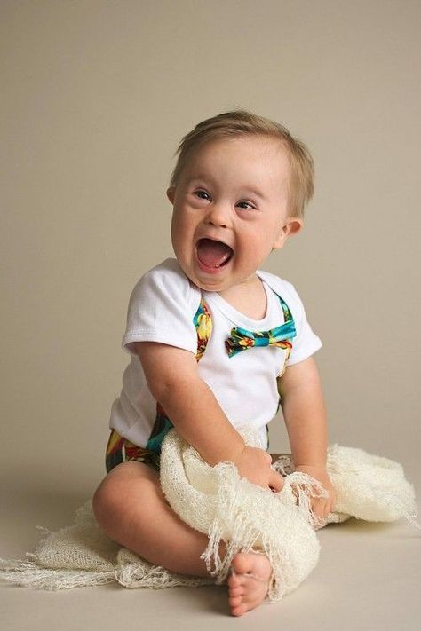 Young boy with down syndrome with a huge smile on his face
