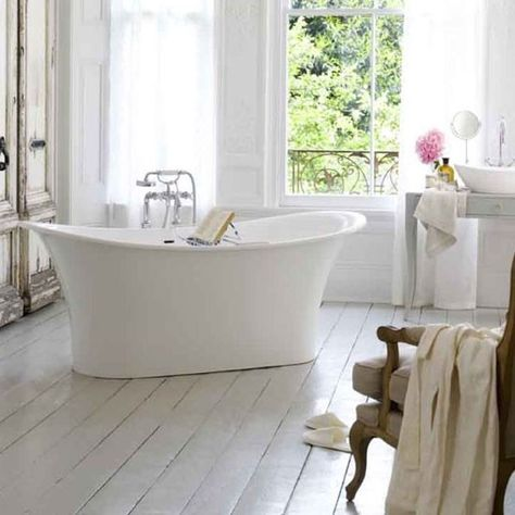 A simple freestanding bath with a view out onto lush countryside is the dream for many fans of coutry style. Keep the look simple with whitewashed floorboards and simple muslin drapes.